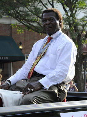 Lou Brock hears the cheers from the crowd during the Parade of Legends at Hall of Fame Weekend 2011 in Cooperstown. (Milo Stewart Jr./National Baseball Hall of Fame and Museum)