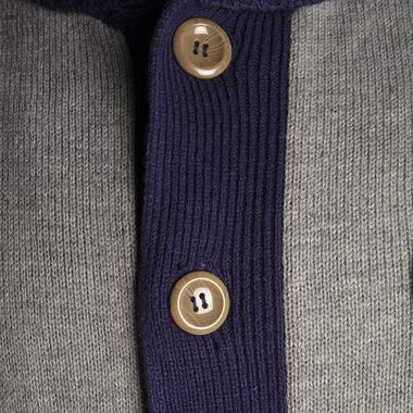 This exclusive cardigan sweater features six tortoise-shell style buttons.