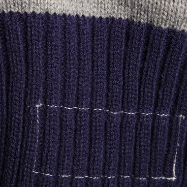 This exclusive cardigan sweater features a mock jock tag stitching on the hem.