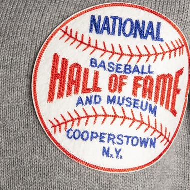 This exclusive cardigan sweater features a 5-inch diameter Hall of Fame felt patch.