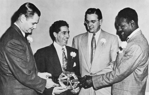 Phil Rizzuto won the first Hickok Belt following his stellar 1950 season with the Yankees. From left, Ray Hickok, Rizzuto, Jim Konstanty and Sugar Ray Robinson admire the belt. (Ray Hickok Collection/Tony Wells Agency)