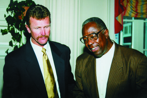 Hank Aaron, right, and Robin Yount – two Milwaukee legends – share a moment at Hall of Fame Weekend 1999 in Cooperstown. (Milo Stewart Jr./National Baseball Hall of Fame and Museum)