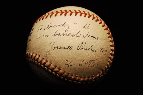 "Sparky Anderson donated this baseball, which was signed for him by Pope John Paul II in 1993, to the National Baseball Hall of Fame and Museum during his orientation tour as a new inductee in 2000. Written in Latin, the Pope's message to Anderson translates as, ""To Sparky, with blessing."" B-17-2002 (Milo Stewart, Jr. / National Baseball Hall of Fame)"