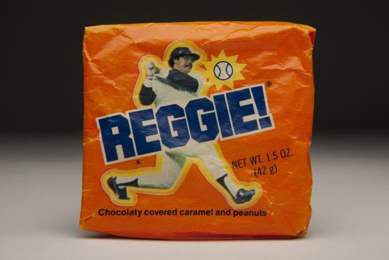 A Reggie! candy bar named after Hall of Famer Reggie Jackson. The caramel bar was first passed out at Yankee Stadium on Opening Day 1978. B-125-93-01 (Milo Stewart, Jr. / National Baseball Hall of Fame)