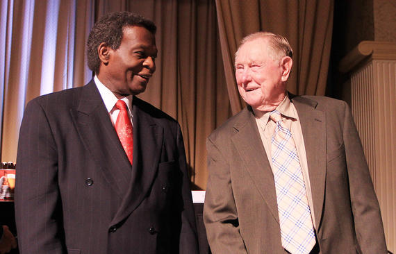 Lou Brock and his Cardinals manager, Red Schoendienst, chat at an event in 2012. Schoendienst managed Brock for 12 seasons in St. Louis. (Bill Greenblatt/National Baseball Hall of Fame and Museum)