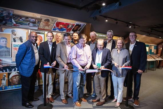 The opening of <em>Shoebox Treasures</em> featured a ribbon cutting event in the Museum's new exhibit. From left to right, first row: Hall of Famer Tim Raines, Hall of Fame President Jeff Idelson, donors Brent Huigens, Bill Janetschek and Tony Yoseloff and Hall of Fame Chairman of the Board Jane Forbes Clark. Second row: Hall of Famers Alan Trammell, Trevor Hoffman, Goose Gossage, Rollie Fingers and Bert Blyleven. (Milo Stewart Jr./National Baseball Hall of Fame and Museum)