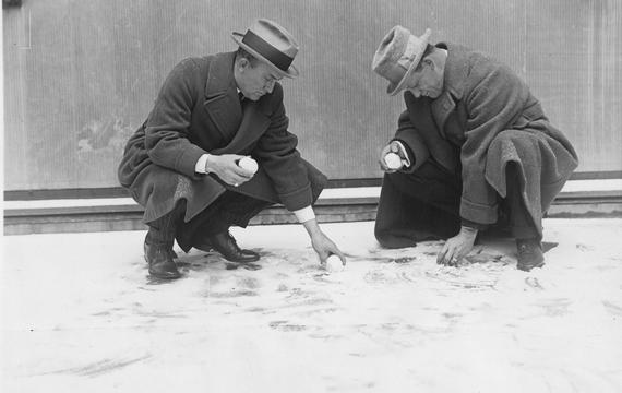 Ty Cobb and Ed Walsh are seen here putting together snow baseballs outside the Hotel Commodore in New York. BL-291-69 (National Baseball Hall of Fame Library)