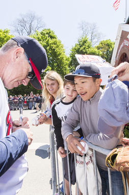 Hall of Fame pitcher Tom Glavine signs autographs for fans before the Hall of Fame Classic Game on May 23, 2015 in Cooperstown, NY. (Jean Fruth / National Baseball Hall of Fame)