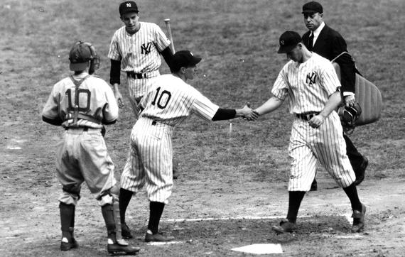 Joe Gordon of the Yankees is congratulated by teammate Phil Rizzuto (10) after hitting a home run in Game 1 of the 1941 World Series against the Dodgers. Gordon was a part of five World Series-winning teams and was named the 1942 American League Most Valuable Player. (National Baseball Hall of Fame and Museum)