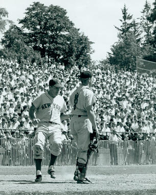 A New York Mets player crosses home plate during the 1964 Hall of Fame Game. (National Baseball Hall of Fame and Museum)