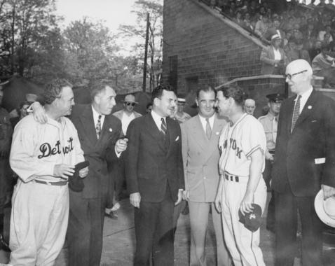 Governor Thomas Dewey attended the 1946 Hall of Fame Game, and is seen here smiling with a member of each team. (Lasell, National Baseball Hall of Fame Library)