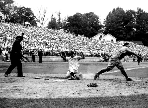New York Yankee Charlie Silvera is thrown out at home plate during the 9th inning of the Hall of Fame Game.