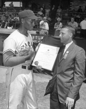 Ernie Banks presents Fred Bowen with the 1959 American Legion Player of the Year Award on June 27, 1960. (National Baseball Hall of Fame and Museum)