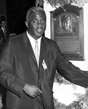 Though the Hall of Fame Game was canceled, fans were treated to an exciting Induction Ceremony in 1962. One of the inductees was Jackie Robinson, pictured above with his plaque. (National Baseball Hall of Fame and Museum)