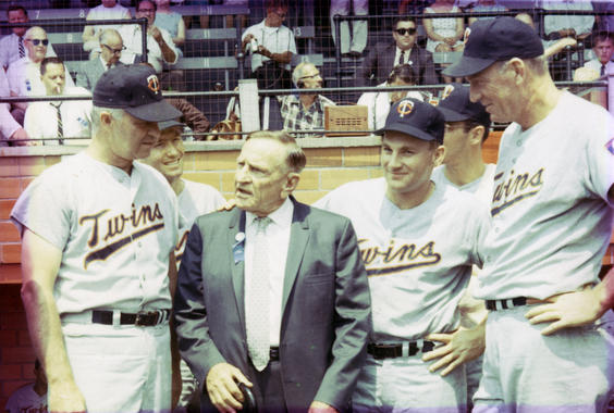 New Hall of Fame inductee Casey Stengel with Harmon Killebrew, fourth from left, and other Twins players at the 1966 Hall of Fame Game. (National Baseball Hall of Fame and Museum)