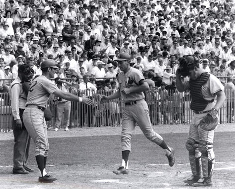 John Boccabella congratulates Expos teammate Bobby Wine as he crosses home plate in the 1970 Hall of Fame Game. (National Baseball Hall of Fame and Museum)