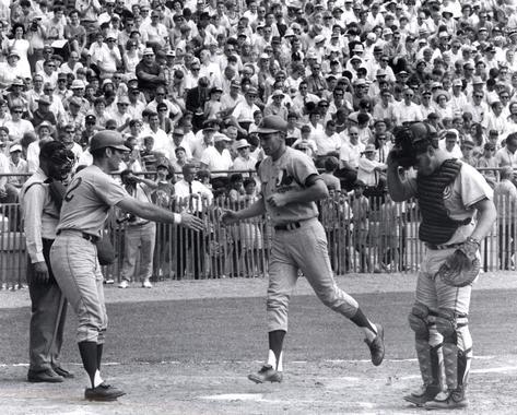 John Boccabella congratulates Bobby Wine as he crosses home plate. (National Baseball Hall of Fame Library)