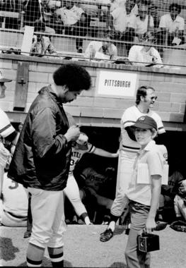 Pittsburgh Pirates pitcher Dock Ellis signs an autograph for a young fan at Doubleday Field on Aug. 6, 1973, at the Hall of Fame Game. (National Baseball Hall of Fame and Museum)