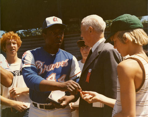 Hank Aaron signs autographs before the Hall of Fame Game on Aug. 12, 1974. (National Baseball Hall of Fame and Museum)