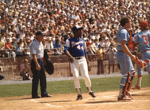 Hank Aaron crosses home plate for the Atlanta Braves against the Chicago White Sox during the Hall of Fame Game on Aug. 12, 1974 at Doubleday Field. (National Baseball Hall of Fame and Museum)