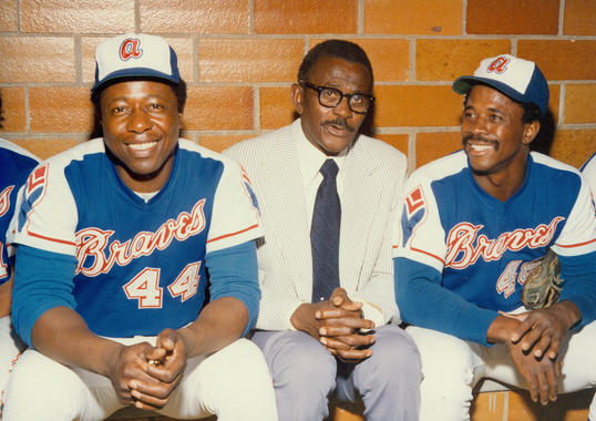 Ralph Garr, far right, with Hank Aaron and Satchel Paige in the Braves dugout at the Aug. 12, 1974, Hall of Fame Game at Doubleday Field. (National Baseball Hall of Fame and Museum)