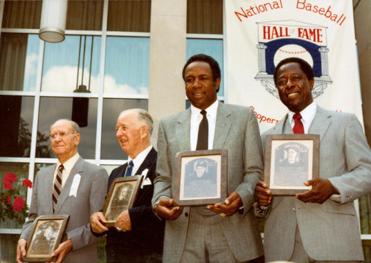 From left, Veterans Committee electees Travis Jackson and Happy Chandler receive their Hall of Fame plaques with BBWAA electees Frank Robinson and Hank Aaron during the Hall of Fame Induction Ceremony on Aug. 1, 1982 in Cooperstown, N.Y. BL-4982-84 (National Baseball Hall of Fame Library)