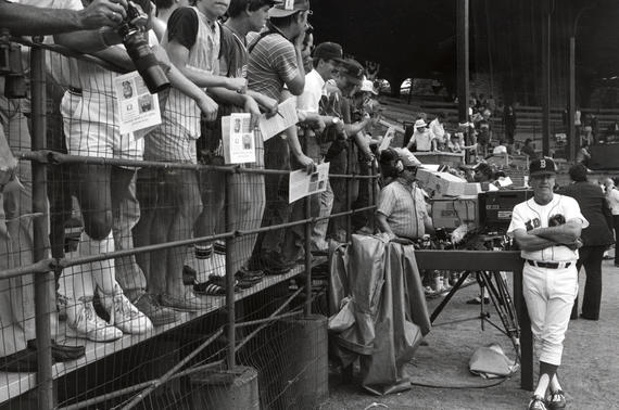 Red Sox first base coach Joe Morgan takes in the view at Doubleday Field at the 1985 Hall of Fame Game. (National Baseball Hall of Fame and Museum)