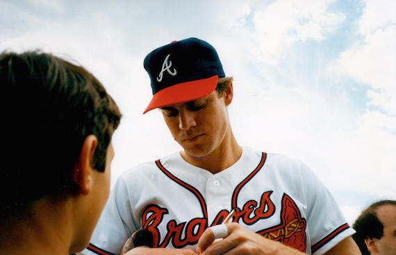 Braves outfielder Dale Murphy signs a ball for a fan at the Hall of Fame Game on July 27, 1987. (National Baseball Hall of Fame and Museum)