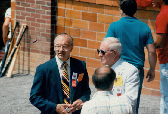 Hall of Fame President Howard Talbot, right, and Museum Associate Director Bill Guilfoile chat on Doubleday Field before the 1989 Hall of Fame Game. (National Baseball Hall of Fame and Museum)