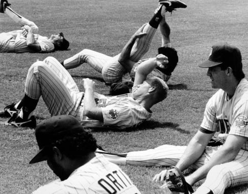 Minnesota Twins players, including Junior Ortiz (foreground), stretch prior to the 1991 Hall of Fame Game. (National Baseball Hall of Fame and Museum)