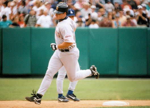 The Padres' Ken Caminiti rounds the bases after hitting a home run at the 1997 Hall of Fame Game. (Tom Ryder/National Baseball Hall of Fame and Museum)