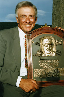 Phil Niekro posing with his plaque during the 1997 Hall of Fame Weekend. (National Baseball Hall of Fame Library)