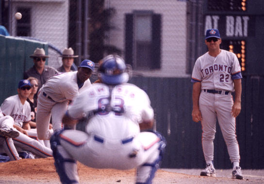 Blue Jays bullpen coach Sal Butera (22) watches warm-ups at the Hall of Fame Game on July 27, 1998. (National Baseball Hall of Fame Library)