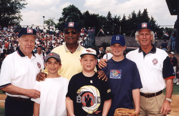 Hall of Fame Inductees Larry MacPhail, Larry Doby and Don Sutton at game with kids who caught their ceremonial first pitches of the game. (National Baseball of Fame Library)