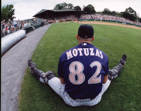 Jeff Motuzas, the bullpen catcher for the Arizona Diamondacks, watches the action from right field. (Tom Ryder / National Baseball Hall of Fame Library)
