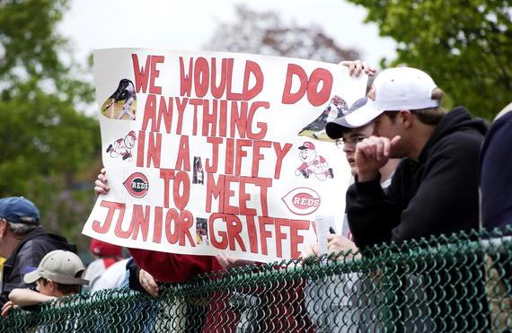 A Cincinnati Reds fan holds up a comical sign about their desire to meet Ken Griffey, Jr. (Milo Stewart Jr., National Baseball Hall of Fame Library)
