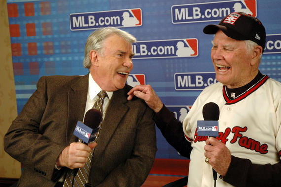 Doug Harvey shares a laugh with MLB.com columnist Hal Bodley during the 2009 Winter Meetings in Indianapolis following Harvey's election to the Hall of Fame. (Photo courtesy of MLB)