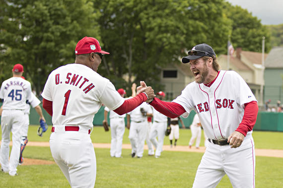 Ozzie Smith (left) and Wade Boggs high-five during the home run derby at the 2017 Hall of Fame Classic. (Jean Fruth/National Baseball Hall of Fame and Museum)
