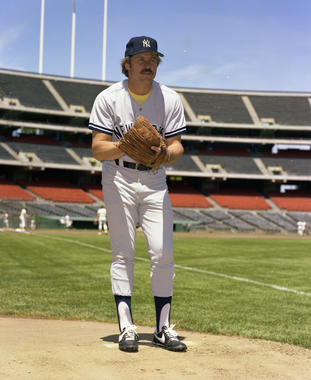Catfish Hunter left the Athletics via free agency following the 1974 season and signed with the Yankees. In his first season in New York, Hunter led the American League with 23 wins and 328 innings pitched. (Doug McWilliams/National Baseball Hall of Fame and Museum)