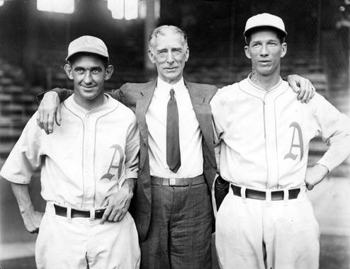 Connie Mack was manager of the Philadelphia Athletics for 50 years, winning nine pennants and five World Series titles. He is pictured above with A's catcher Mickey Cochrane (left) and pitcher Lefty Grove (right). (National Baseball Hall of Fame)