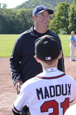 Hall of Fame pitcher Greg Maddux enjoys a laugh with a young fan during the 14th annual PLAY Ball fundraiser Friday morning at the Clark Sports Center in Cooperstown. (Milo Stewart, Jr. / National Baseball Hall of Fame)