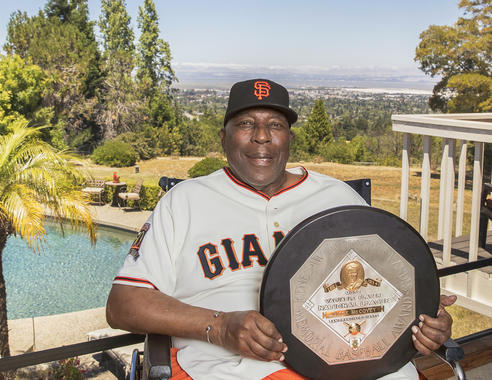 Juxtaposed against a beautiful California sky, Willie McCovey is posed with his 1969 National League Most Valuable Player Award. He put all the pieces together in 1969, leading the league with 45 home runs and 126 RBI while hitting .320 and drawing a league-best 45 intentional walks. (Jean Fruth / National Baseball Hall of Fame)