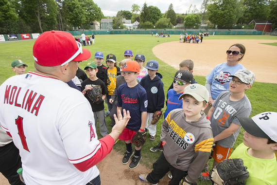 Former Gold Glove Award-winning catcher Bengie Molina gives advice to some budding major leaguers at the 2015 Cooperstown Classic Clinic. (Jean Fruth / National Baseball Hall of Fame)