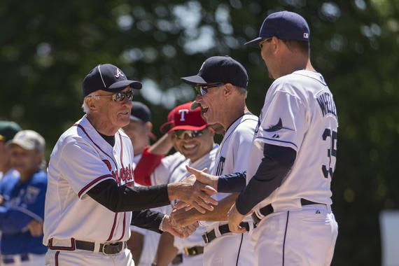 Hall of Fame pitcher Phil Niekro (left) greets members of Team Knucksie before the 2015 Hall of Fame Classic Game in Cooperstown, NY. (Jean Fruth / National Baseball Hall of Fame Library)