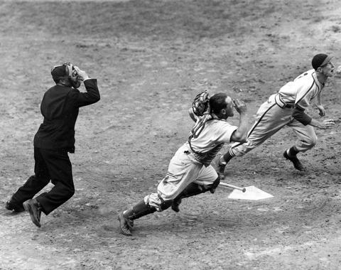 Red Schoendienst attempts to bunt during the sixth inning of Game 2 of the 1946 National League playoff series between the Cardinals and the Dodgers at Ebbets Field. The catcher is Brooklyn's Bruce Dewards and the umpire is Babe Pinelli. (National Baseball Hall of Fame and Museum)