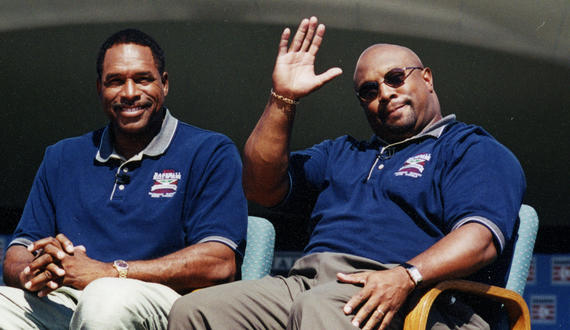Dave Winfield (left) and Kirby Puckett acknowledge the crowd during the Legends of the Game event at Hall of Fame Weekend 2001 in Cooperstown. (Milo Stewart Jr./National Baseball Hall of Fame and Museum)