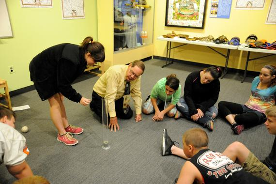 Museum teacher Richard Payne conducts an experiment with a visiting school group in the Museum's Learning Center to demonstrate the connections between science and baseball. (Milo Stewart, Jr. / National Baseball Hall of Fame)
