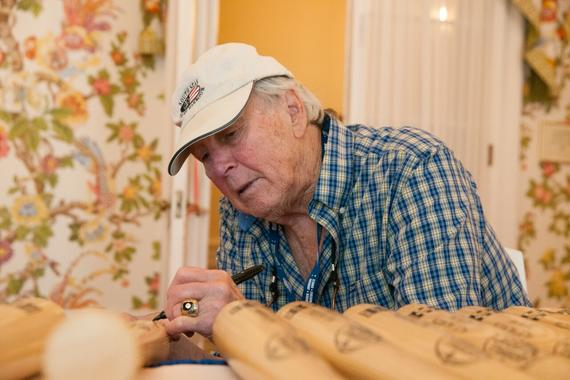 Hall of Fame third baseman Brooks Robinson signs a bat in Cooperstown's Otesaga Hotel on July 23, 2015. (Milo Stewart, Jr. / National Baseball Hall of Fame)