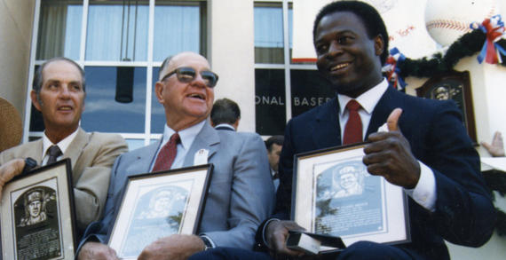 Class of 1985 members (from left) Hoyt Wilhelm, Enos Slaughter and Lou Brock share a moment at the Induction Ceremony on July 28, 1985 in Cooperstown. (National Baseball Hall of Fame and Museum)