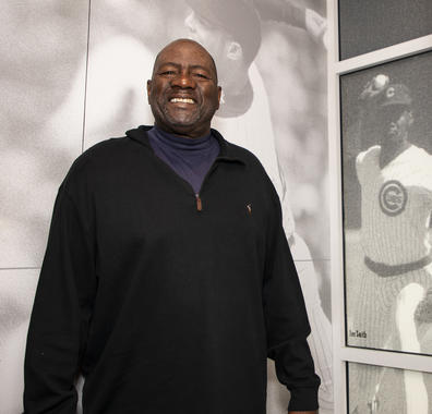 Lee Smith poses by a photo of him during his playing days located in the Museum's Bullpen Theater. Smith, a 2019 Hall of Fame electee, held the big league saves record for 13 years. (Milo Stewart Jr./National Baseball Hall of Fame and Museum)